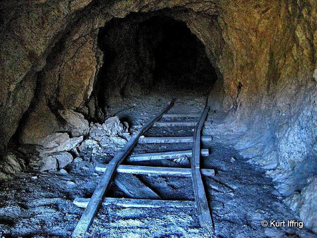 The Bell Harman Mine or Boatwright Prospect is about 60 feet deep.