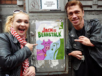 Mat and Julie holding the Jack and the Beanstalk poster.