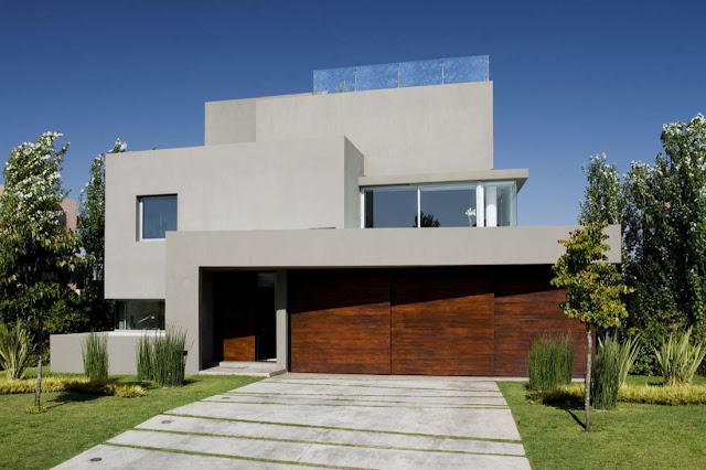 Modern home with wooden garage doors