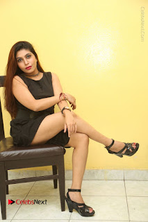 Tollywood Upcoming Actress Pooja Roshan Stills in Black Short Dress at Plus 1 Movie Trailer Launch  0310.JPG