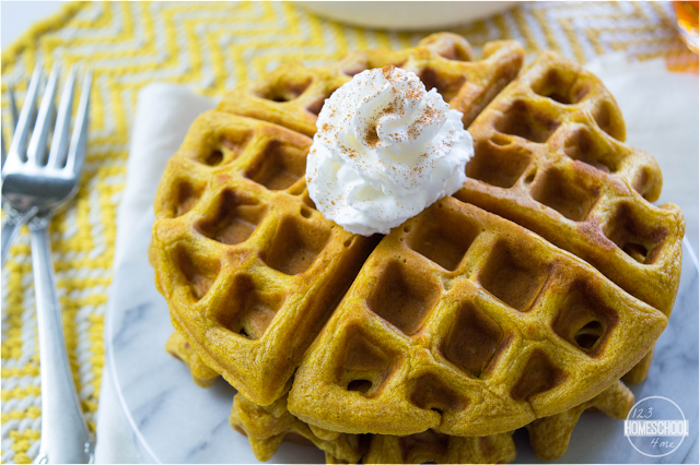 serve homemade pumpkin waffles with a dollup of whipped cream with a sprinkle of cinnamon on top