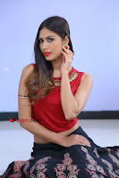 Telugu Actress Nishi Ganda Stills in Red Blouse and Black Skirt at Tik Tak Telugu Movie Audio Launch .COM 0119.JPG