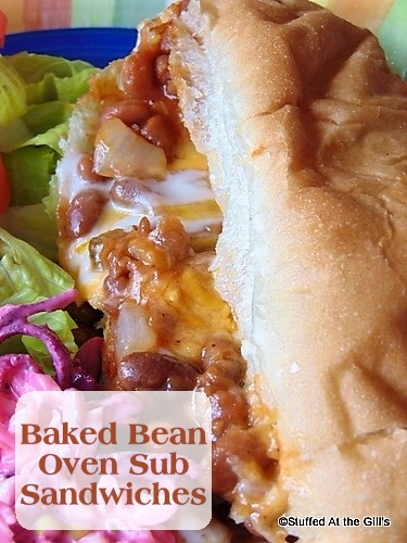 Baked Bean Oven Sub Sandwich served with Pink Cole Slaw and lettuce with tomato slices.