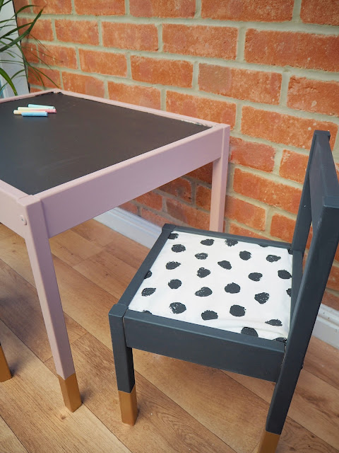 DIY IKEA hack turning the LATT childrens table and chairs upcycled into a chalkboard drawing station using chalkboard paint, dalmatian fabric to create seat pads and gold dipped legs. Perfect for nursery or playroom decor and a budget way to create a stylish table and chairs for your children. DIY home interior decor.