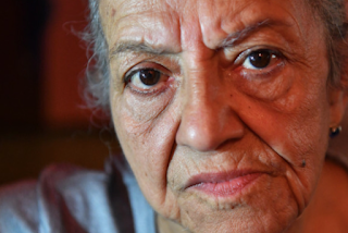 'God, Take Care Of This': Gunmen Attack Grandma In Home Invasion