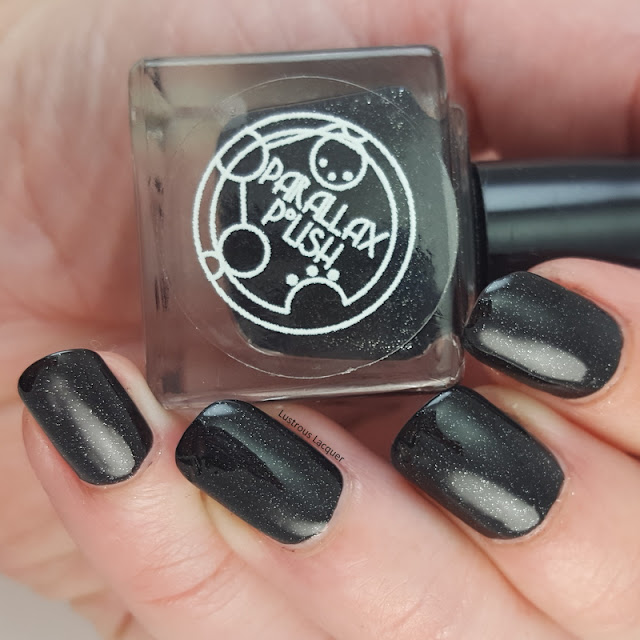 Matte-black-nail-polish-with-silver-foil-flecks
