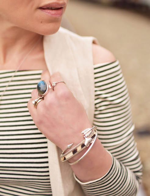 striped off-the-shoulder top, sleeveless linen coat, stacked bracelets and rings