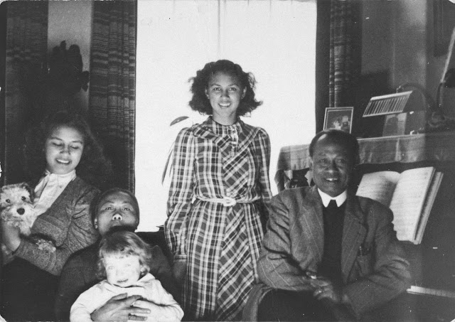 men and women with a little boy at home setting