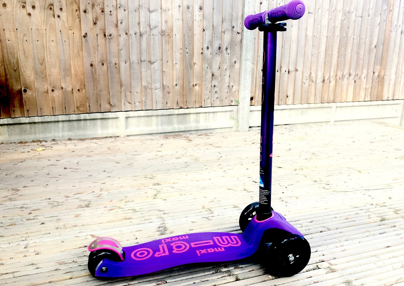 Purple scooter with pink highlights on decking