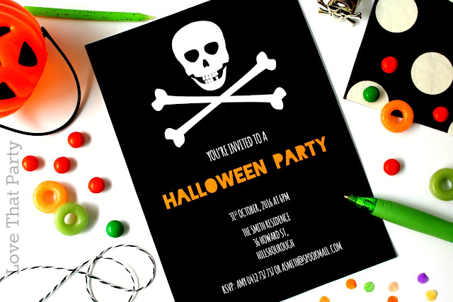 image of printable Halloween invitation with skull and crossbones in black white orange
