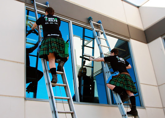 Men In Kilts Washing Windows