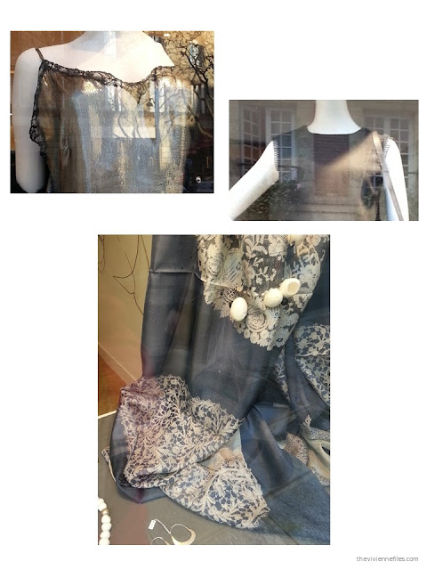 lace trim on garments, and a lace scarf, in the shop windows of Paris