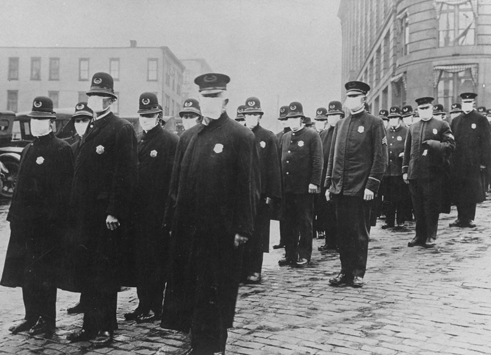 Seattle policemen wear protective gauze face masks during the influenza epidemic. 1918.