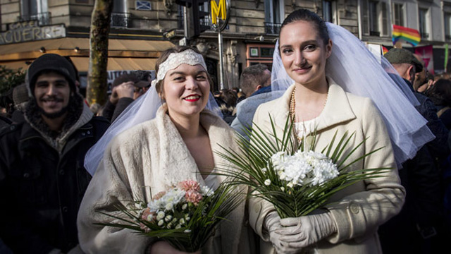 Women pose during a demonstration for legalisation same-sex marriages