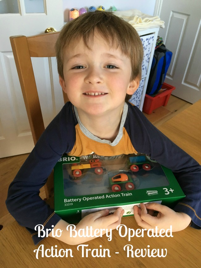 Brio-Battery-operated-action-train-review-text-over-image-of-boy-with-train-box