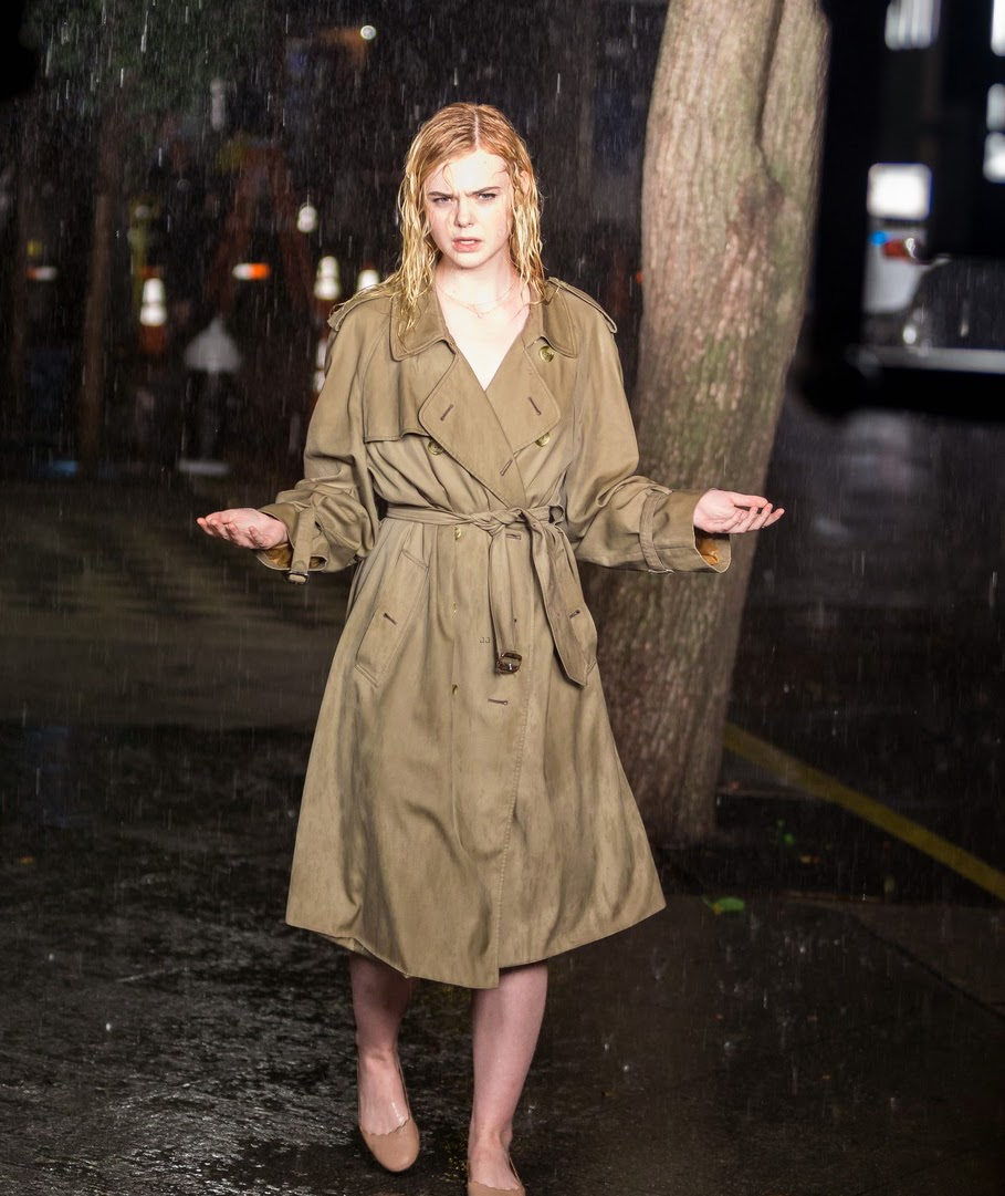 elle fanning getting soaked on set of upcoming woody allen