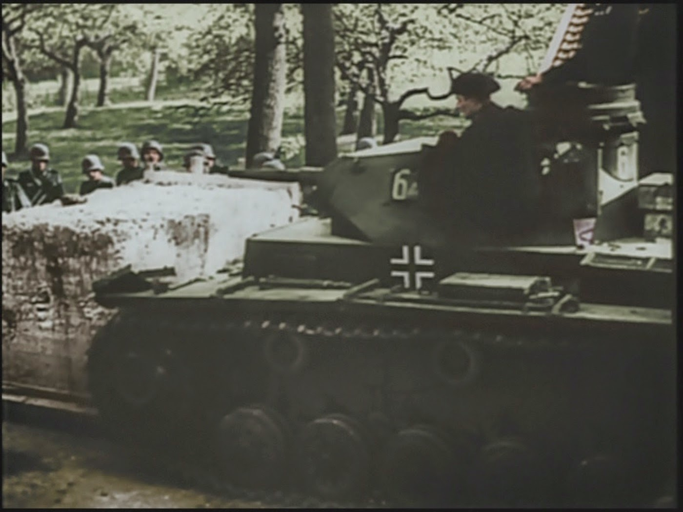 A Pz III pushes aside a frontier barrier in Belgium