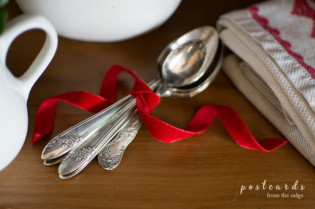 old silver spoons and red velvet ribbon
