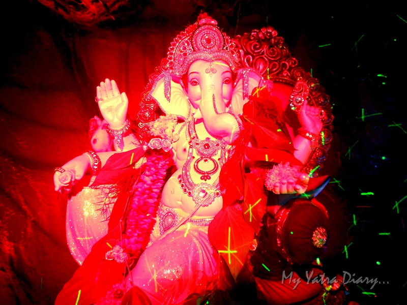 Beautiful, glittering lighting and decoration in red, Ganesh Pandal Hopping, Mumbai