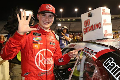 Christopher Bell affixes the winner's decal to his car in Victory Lane