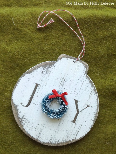 A miniature wreath is the perfect addition to this handmade ornament.