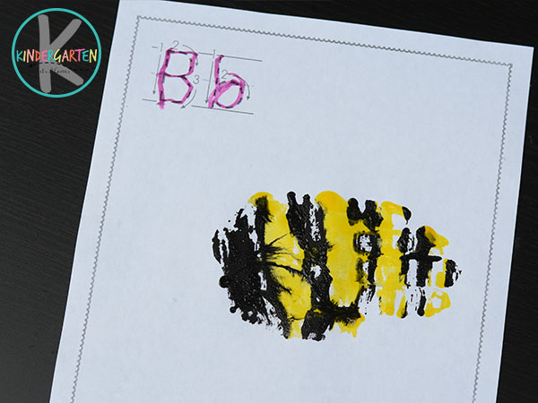 use yellow and black tempera paint to make this cute bee craft for kids
