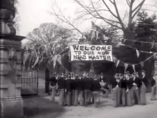 Boys gather to welcome Dr Smart-Alec at Narkover - (1935)  Screen grab from film by the North Mymms History Project