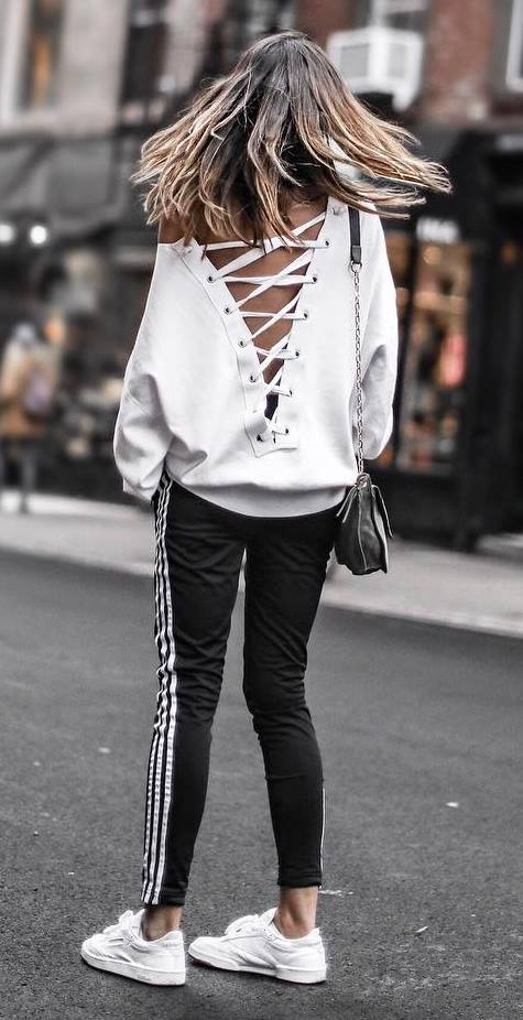 cute outfit idea_lace up sweater + bag + stripped pants + sneakers