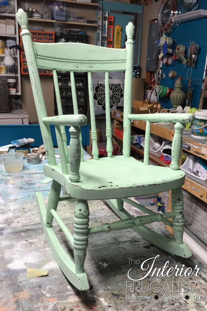 A rustic rocking chair makeover with farmhouse style for a child. It's a quick and easy upcycle for a solid wood vintage toddler rocker painted green.