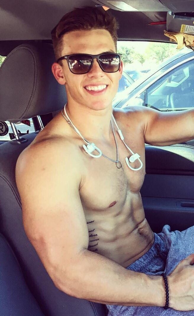 cute-boy-smiling-driving-car-shirtless-abs