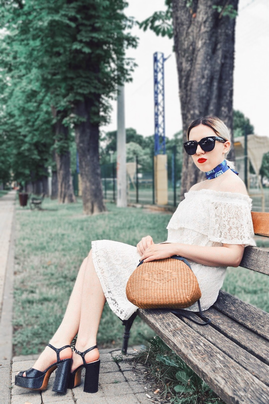 white lace dress and straw bag