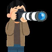 大きな望遠レンズのカメラを構える人のイラスト