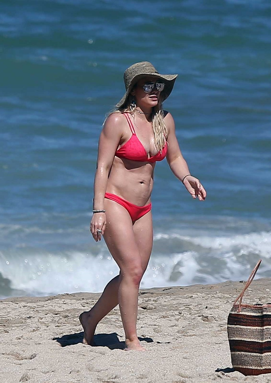Hilary Duff bares bikini body at a beach in Mexico