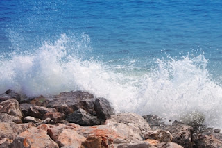 """Wave Crash Against With Rock Beach"" by Keerati freedigitalphotos.net"