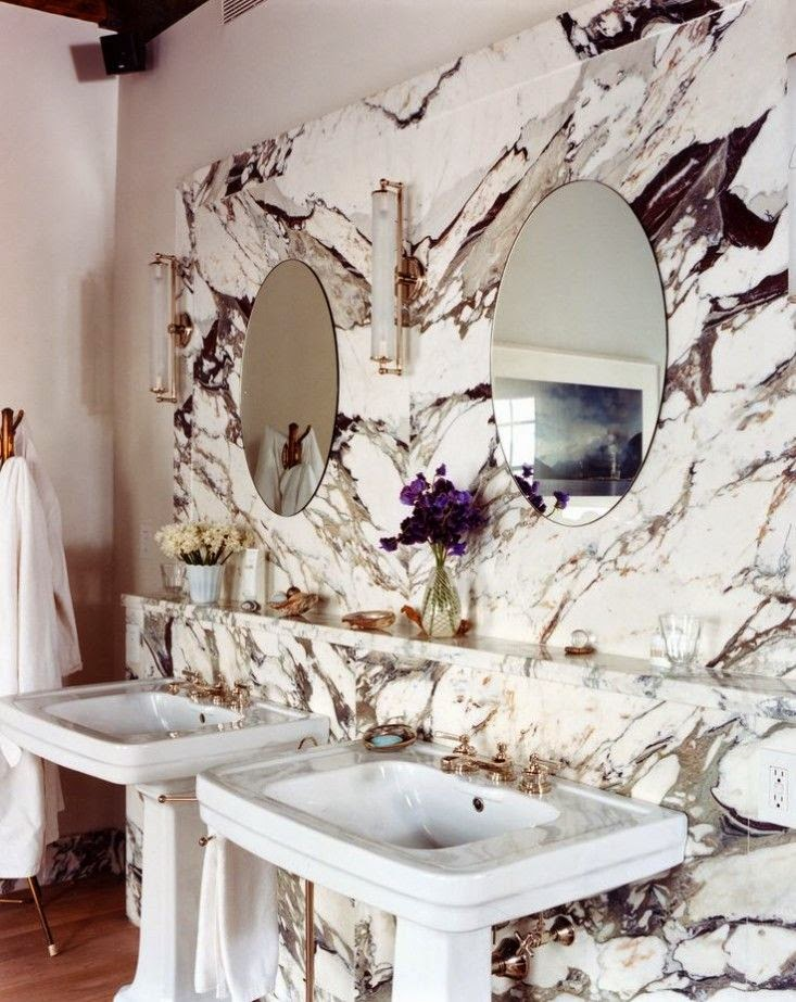 Heavily veined exotic marble bathroom with two pedestal sink