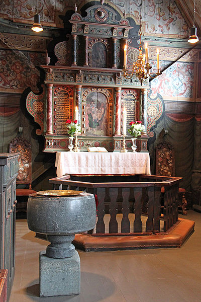 Interior view of the Røldal church shows the 13th-century Baptismal font.