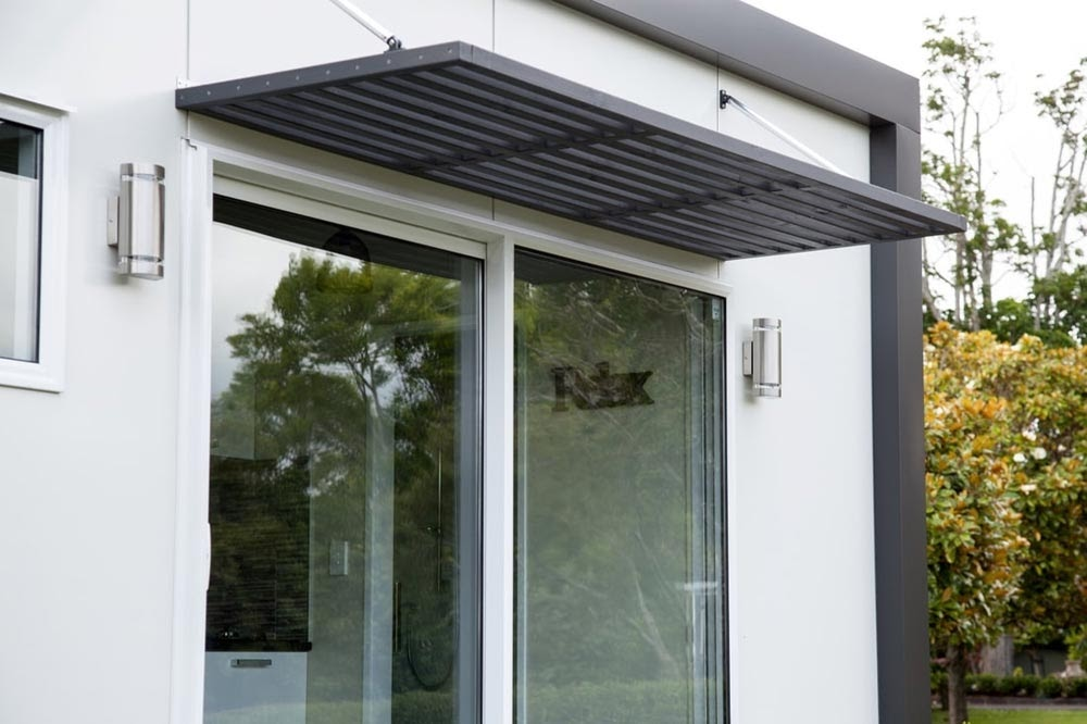 10-External-Porch-NZ-Tiny-House-Minimalist-and-Space-Age-Architecture-www-designstack-co