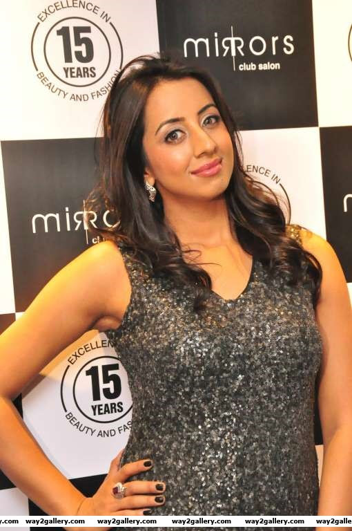 Sanjjanaa poses for photographers during the launch of Mirrors Club Salon