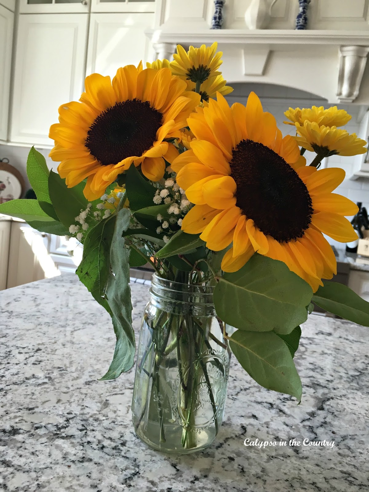 Sunflowers in the White Kitchen - Inspired me to display them with my blue and white porcelain