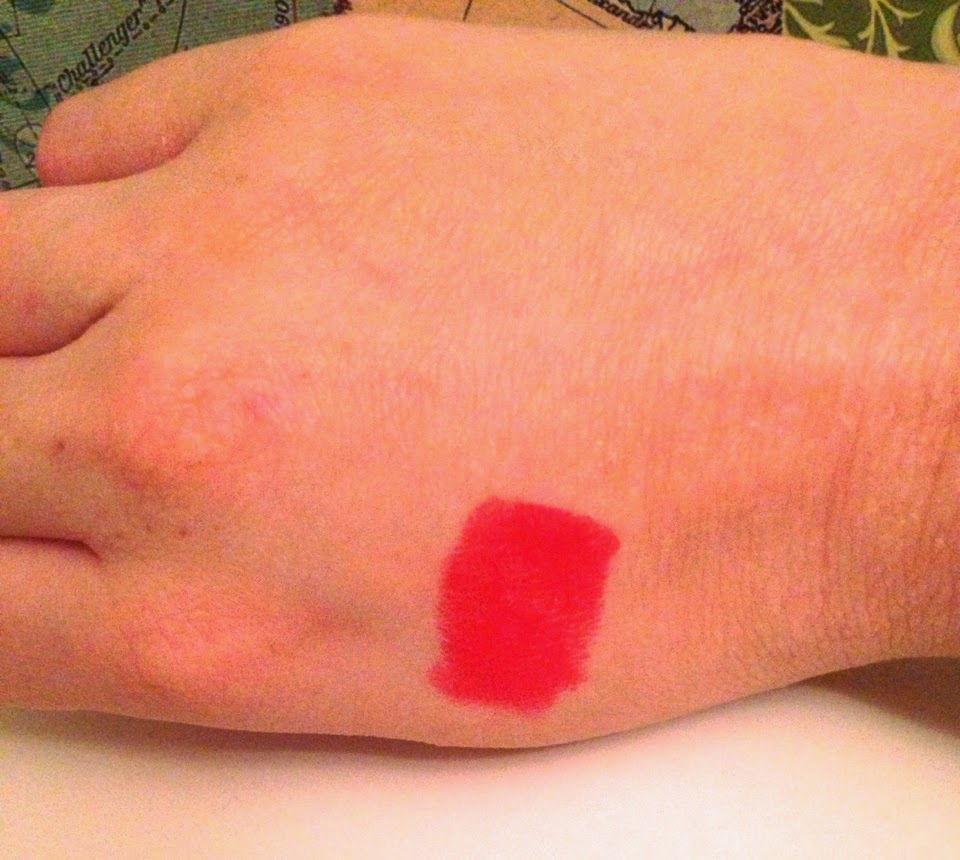 a swatch of nars lipstick in the shade heatwave
