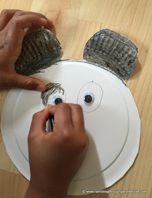 Colour in the Paper Plate Panda's eyes and ears
