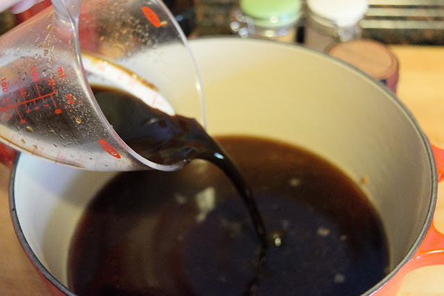 Worcestershire sauce being added to the pot for the bbq sauce.