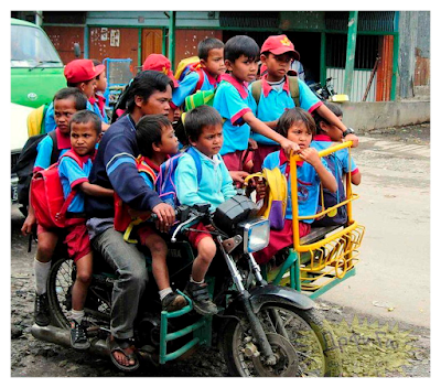 many Asian Pupils on a bike
