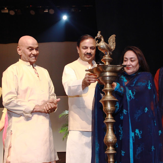 Raja Radha Reddy, Dr. Mahesh Sharma and Jyotsana Suri lighting the lamp