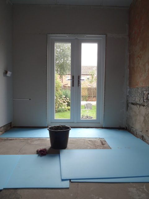 laying insulation boards for underfloor heating
