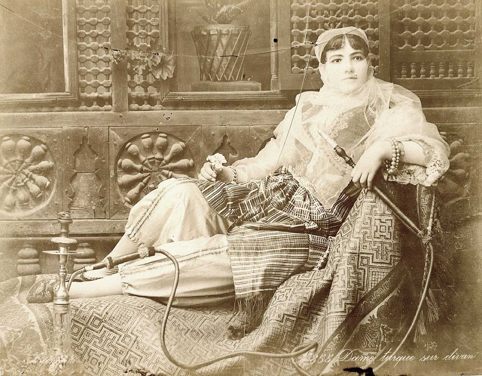 Turkish woman on couch.