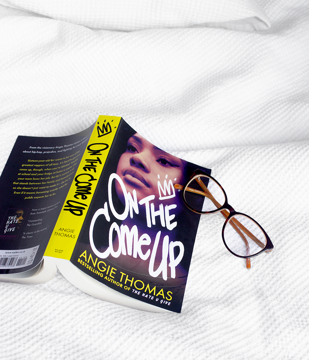 A book review of the popular Angie Thomas novel On The Come Up. [Flatlay of the book]