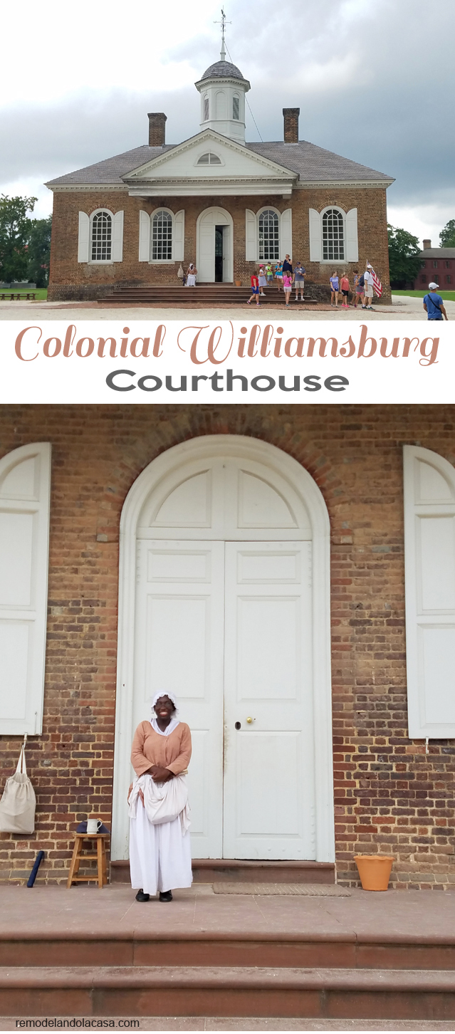 African American lady in front of bid courthouse door - Williamsburg