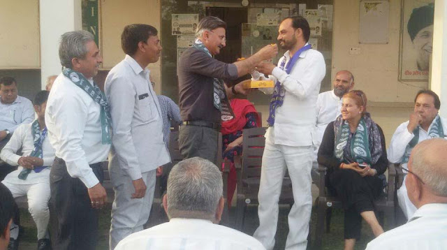 Inollo and BSP leaders celebrate and greet each other with ladoos
