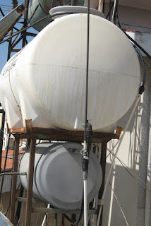 showing the drips down a cold water tank on a roof in Cyprus